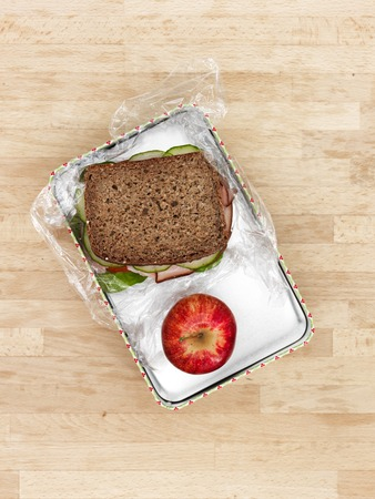 quick snack: A studio photo of a sandwich at work