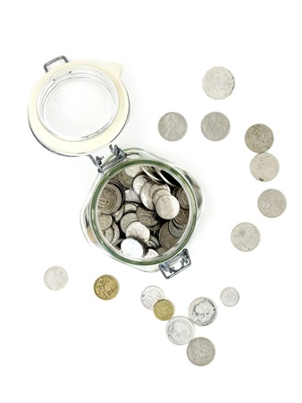 money jar: A studio photo of a money jar