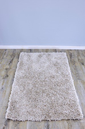 floorboards: A close up photo of a plush floor rug Stock Photo