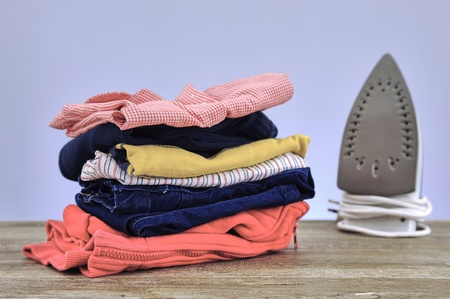 bright housekeeping: A studio photo of ironing and laundry items