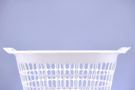 launderette: A studio photo of a laundry washing basket