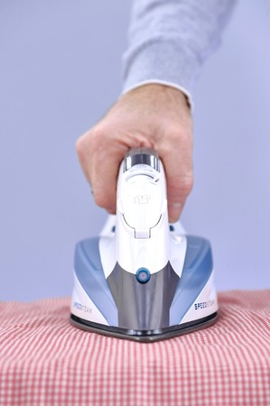 household tasks: A studio photo of ironing and laundry items