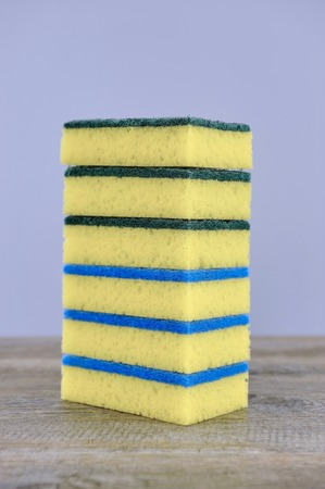 padding: A close up studio photo of a dishwashing sponge