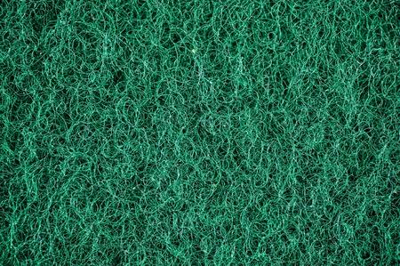dishwashing: A close up studio photo of a dishwashing sponge