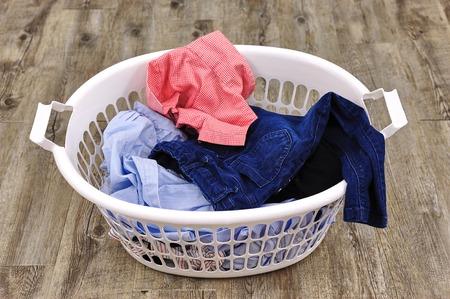 descriptive colour: A studio photo of a laundry washing basket