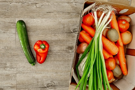 A studio photo of a fruit and vegetable box