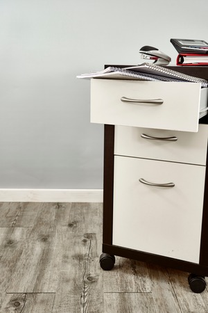 drawers: A studio photo of a chest of business drawers