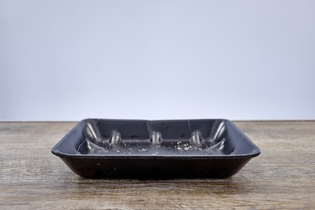 A studio photo of a plastic food tray