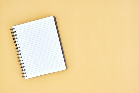 handbooks: A close up shot of a notebook writing pad