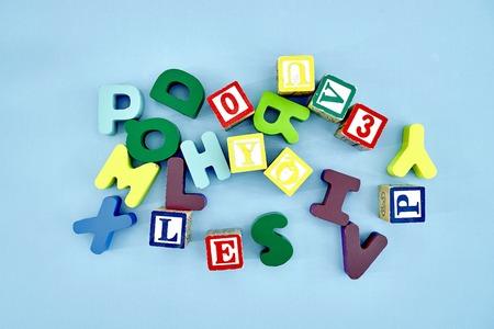 A studio photo of wooden alphabet letters