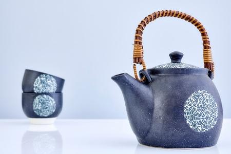 A studio photo of a black tea pot