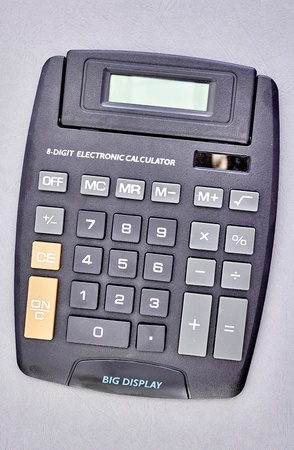A studio photo of an electronic business calculator Stock Photo