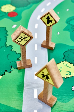 A studio photo of toy road signs