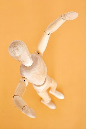 A studio photo of a wooden toy mannequin Stock Photo