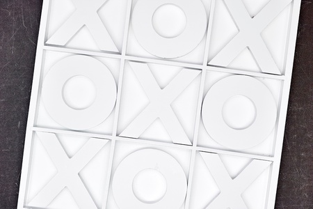 CHALLENGING: A studio photo of naughts and crosses