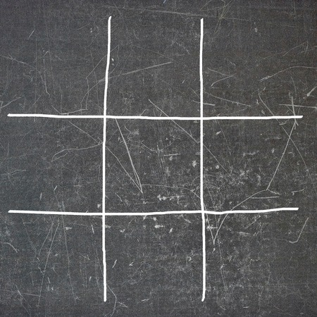 A studio photo of naughts and crosses