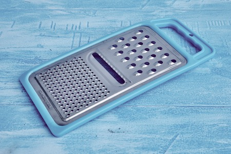 metal grate: A studio photo of a kitchen grater