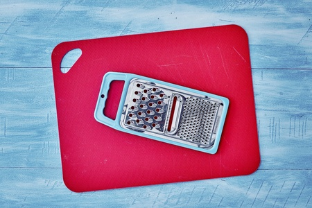 A studio photo of a kitchen grater