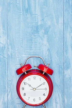 A studio photo of an alarm clock