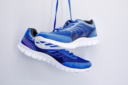 A studio photo of a pair of runners