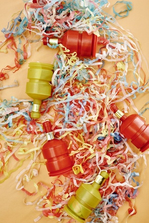 A studio photo of party poppers