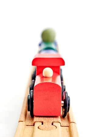 A studio photo of a wooden train track Stock Photo