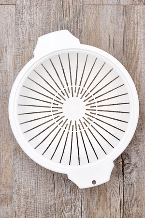 A studio photo of a food strainer