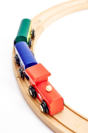 A studio photo of a wooden train track Stock Photo