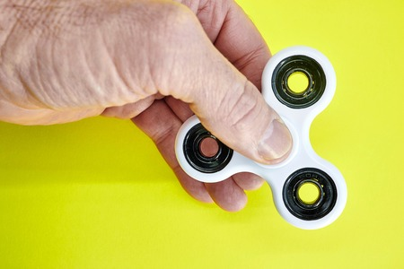 A studio photo of a finger spinner Stock Photo