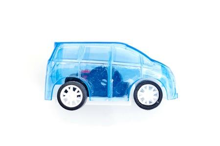 A studio photo of a llittle blue car