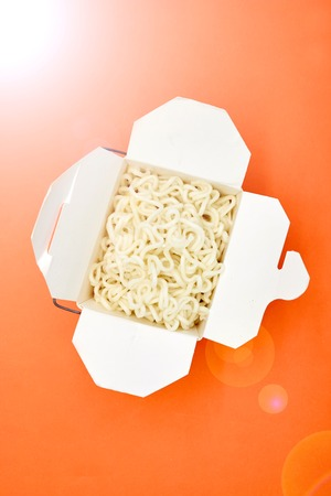 A studio photo of a cup of noodles
