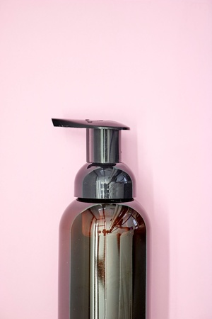 A studio photo of a soap dispenser
