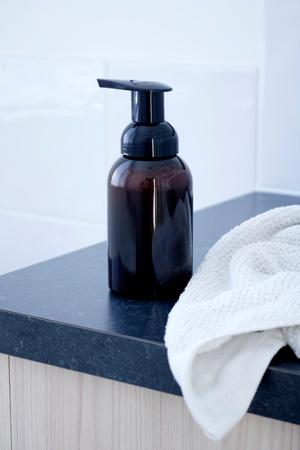 A studio photo of a soap dispenser