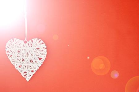 A studio photo of a wicker love heart