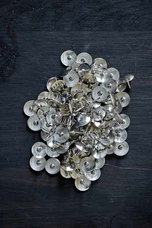 A studio photo of drawing pins