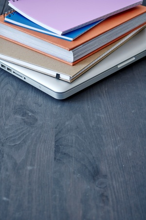 A laptop computer on a wooden desk Stock Photo