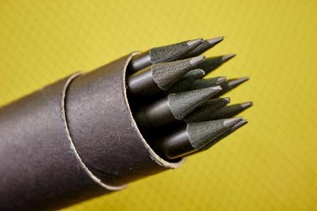 A studio photo of black pencils
