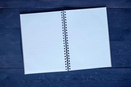 A studio photo of a note book pad