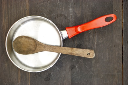A studio photo of a wooden spoon