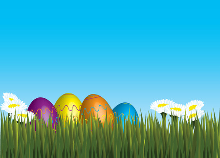 lying in: four decorated easter eggs in matching colors lying in grass