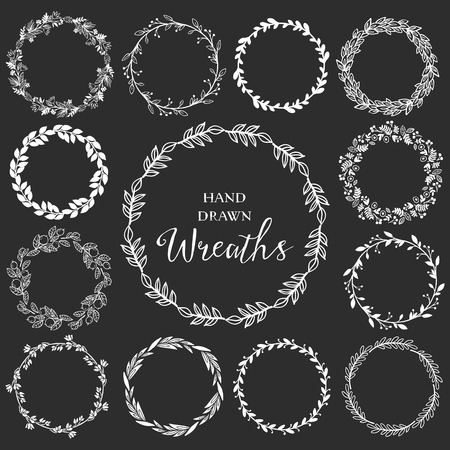 leaf line: Vintage set of hand drawn rustic wreaths. Floral vector graphic on blackboard. Nature design elements.