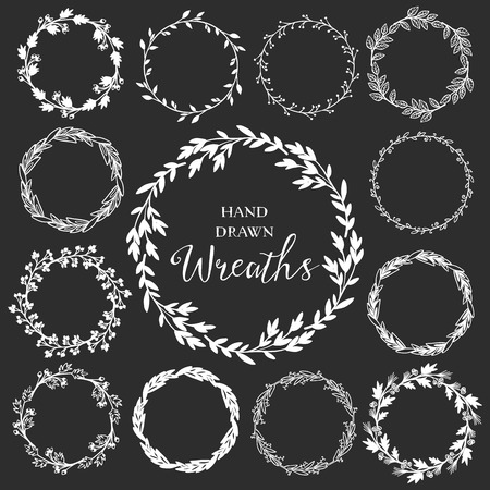laurels: Vintage set of hand drawn rustic wreaths. Floral vector graphic on blackboard. Nature design elements.