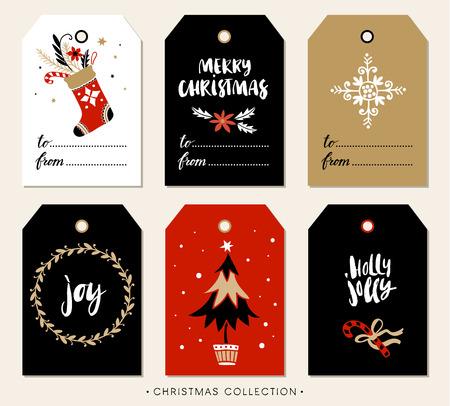 서예와 크리스마스 선물 태그입니다. 필기 현대 브러시 문자 : 메리 크리스마스, 기쁨, 홀리 졸리. 손으로 디자인 요소를 그려.
