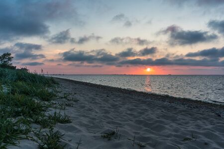 Wide shot of beautiful sunset at the beach of the baltic sea