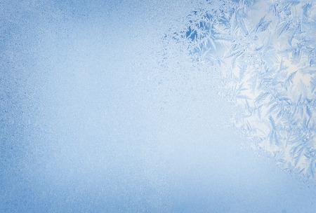 Winter background, frost on window