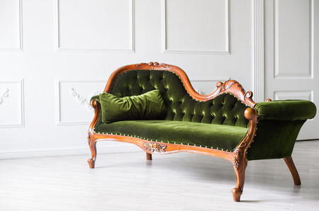 Classical style sofa in a white room Stock Photo - 67561096