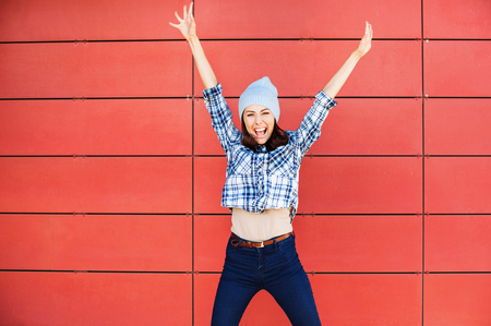 Beautiful young woman portrait. Happy student girl with hands up Stock Photo - 66463323