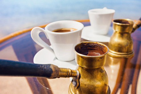 Traditional greek coffee brewed in coffee pot