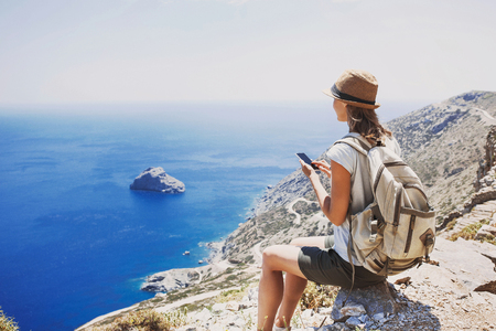 Hiking woman using smart phone