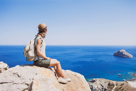 Female traveler looking at the sea, travel and active lifestyle concept Stock Photo - 74090609